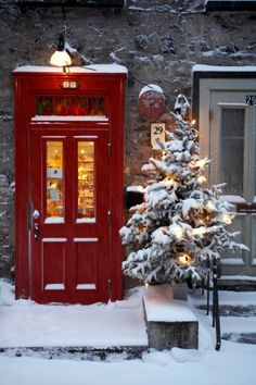 Storefront with red door and decorated Christmas tree, Petit Champlain Street, Quebec City