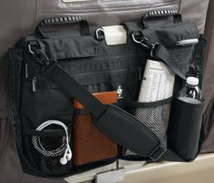 seat organizer hooks on to your tray table and includes pockets for everything from books to a water bottle. Once zipped, it converts to an easy-to-carry case that keeps everything in place.