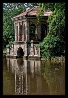 Birkenhead Park, The Wirral, Cheshire, England, U.K.    From the archives: A classic shot of The Boathouse in the park.  This park is part of my childhood and brings back a lot of memories.    It is widely accepted that, after visiting the park in 1850, American landscape architect Frederick Law Olmsted incorporated many of the features he observed into his design for New York's Central Park.  Wikipedia.