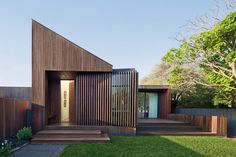The steeply pitched skillion roof turns away from the two-storey western neighbour to greet visitors at the street.