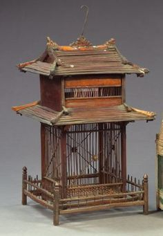 Southeast Asian Carved Wood and Wire Birdcage, of two-story house form, first quarter 20th century