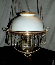 ANTIQUE MILLER HANGING OIL LAMP ( MILKGLASS SHADE AND SMOKE BELL)