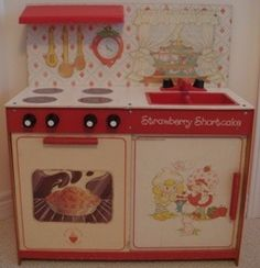 I loved my Strawberry Shortcake kitchen! I had this exact one, I wish I woulda kept it for my future kids... I swear the 80's had the best toys!