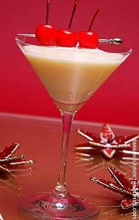 Mistletoe Kiss   (- 1 1/2 oz Smirnoff cranberry flavored vodka  - 1 1/2 oz pineapple juice  - 1 oz coconut cream  Garnish: maraschino cherries)