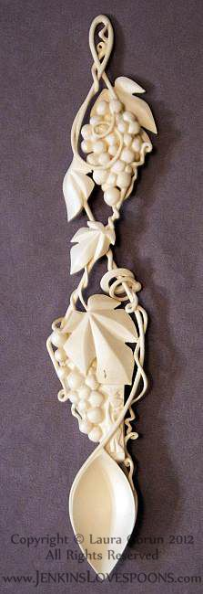 A beautiful love spoon designed and deftly carved to the highest degree of finish and brave intricacy from holly by Lara Gorun.