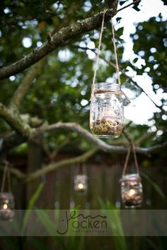 Mason jars with candles hanging from the trees.  I'm going to do this in my back yard.