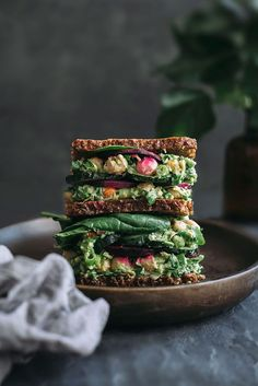 Chickpea salad sandwich with creamy avocado pesto, spinach and beet chips