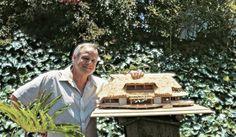 "Marlon Brando with model of his ""dream resort"" in Tahiti isle of Tetiaroa. Photo by Bernard Judge 1983."