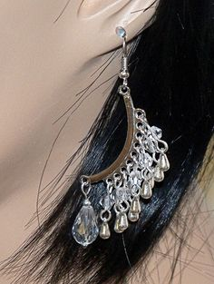 Silvertone Curved Crystal Raindrop Dangle Earrings by Ricksiconics, $16.00
