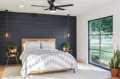 In one of their biggest stylistic challenges yet, our fearless Fixer Upper duo has a tall order to fill when a couple moving from Denver wants a country retreat — but a house with thoroughly modern vi Dark Accent Walls, Accent Wall Bedroom, Bedroom Ceiling, Bedroom Lighting, Ship Lap Accent Wall, Plank Wall Bedroom, Bedside Lighting, Bedroom Windows, Bedroom Lamps