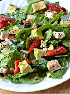 Strawberry-Avocado-Chicken-Salad-with-Orange-Poppy-Seed-Dressing. Crispy baby spinach, strawberries, creamy avocado, salty feta cheese, almonds and cranberries are topped off in a deliciously light and summery orange poppy seed dressing!
