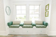 Love this window seat... perfect to curl up and read a book.
