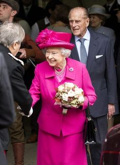 Queen Elizabeth II and Prince Philip visit London's National Theatre on October 22, 2013.