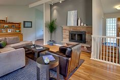 family room, gray accent wall, light wood floor, stone fireplace (Benjamin Moore, Silver Streak)