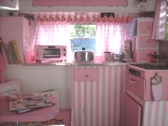 omg- it's a pretty in pink explosion of candystripes.  pink stripes and decor in a tiny trailer  Zel, Lula and MissFinn would love this