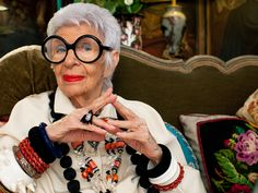 """An AFternoon with Iris Apfel: Better With Age """"I like to put together things that supposedly don't go together, and I like offbeat things — never the standard equipment. I don't prefer Georgian things, though they can be beautiful, but I love Italian furniture, baroque mainly. I don't care whether pieces are expensive or junk. I took the idea of my wall paneling from Louis XVI. My two chairs with the orange are Sicilian 18th century."""""""
