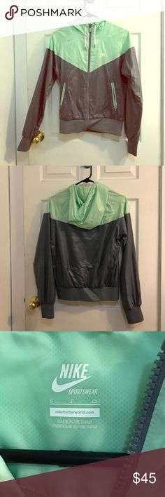 Nike windbreaker Like new Nike windbreaker jacket. Size small. True to size, and inflexible fabric with the exception of a bit of stretch at the waist at wrists. Mint and grey with a matte metallic finish. In excellent condition, only worn a couple times. Price is firm unless bundling. Nike Jackets & Coats