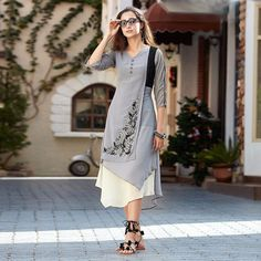 Haute Embroidered Work Faux Georgette Grey Party Wear Kurti Make the heads flip whenever you costume up with this wonderful grey faux georgette party wear kurti. The brilliant dress creates a dramatic canvas with superb embroidered work. Dress Neck Designs, Blouse Designs, Stylish Kurtis Design, Stylish Dresses, Fashion Dresses, Fancy Kurti, Kurta Designs Women, Kurti Designs Party Wear, Indian Designer Wear