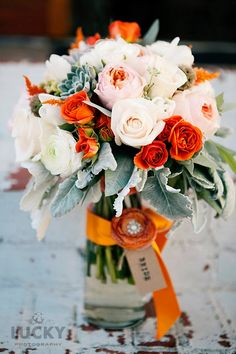mariee ami weddings.  Beautiful flowers. peach, orange, gray.  love.