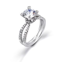 Passion Collection - This gorgeous 18K white engagement ring is comprised of .57ctw round white Diamonds. - GR204