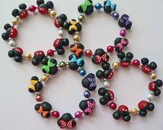 Mickey Mouse Minnie Mouse inspired clay bead Jewelry Bracelet Rainbow Polka Dot Bows Hypoallergenic Children Kids Adult mini mouse ears. $17.99, via Etsy.