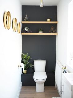 Under the stairs toilet inspiration! Anyone who knows me knows that I like things plain and simple and mostly grey! But I'm going to be adventurous and decorate this room navy and gold. I'll only paint the wall behind the toilet navy and the rest white. Small Toilet Decor, Toilet Room Decor, Toilet Decoration, Small Toilet Room, Cloakroom Toilet Downstairs Loo, Bathroom Under Stairs, Under The Stairs Toilet, Down Stairs Toilet Ideas, Beautiful Bathrooms