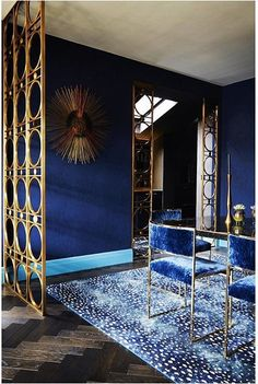 Dining room drenched in blue with antelope rug by Trilbey Gordon