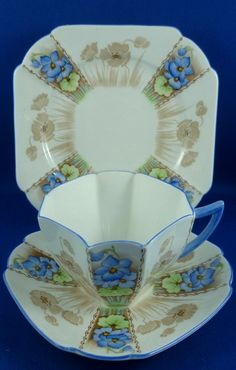 Shelley Queen Anne BLUE PANSY BROWN PANEL tea cup, saucer and plate. RD 723404 Pattern number There is a very small brown spot inside the base of cup.