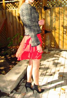 Tiered vintage red dress, cropped tweed blacker, double-buckle stilettos