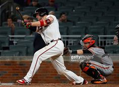 Tyler Flowers of the Atlanta Braves hits a solo homer in the seventh inning after a video review overturned the call against the San Francisco Giants at SunTrust Park on June 21, 2017 in Atlanta,...