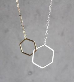 "Two hexagons connect gracefully on a 16"" chain with hexagon detail at the clasp. In polished silver."