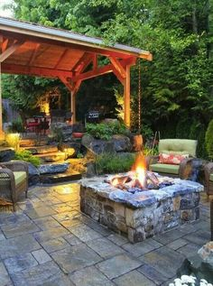 Gorgeous outdoor space with wood gazebo, stone steps, walkway and firepit. Love.