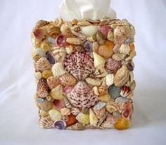 Sea Shell Tissue Box Cover by judystephenson on Etsy, $56.00.. Mine are just as cute , but mucho cheaper :-)
