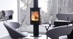 With superb contemporary styling, the Duo 1 wood burning stove features a Pedestal base and a large glass door and side windows that provide breathtaking flame views. Stove Fireplace, Fireplace Design, Glass Front Door, Glass Door, Boiler Stoves, Wood Pellet Stoves, Small Stove, Chimney Breast, Wood Pellets