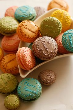 love love love the idea of this! writing flavor names and intricate designs on macarons in the same color either before or after baking. before could be with fine-tipped, thicker macaron batter. after could be closely-tinted royal icing.