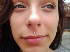 The medusa piercing also known as philtrum piercing. It is a beautiful piece of piercing set in the slope above your lip and directly under the septum of Medusa Piercing Jewelry, Philtrum Piercing, Smiley Piercing, Piercing Aftercare, Piercing Shop, Piercing Ideas, Monroe Piercings, Facial Piercings, Cute Piercings