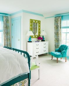 For her bedroom, the oldest daughter preferred a color palette of aqua and lime green in place of more traditional purples and pinks. The wooden bed, an heirloom from her grandmother, was lacquered in a bright teal to fit into the space, and the moldings were painted a bold color to highlight the room's interesting angles. A chic fabric by Katie Ridder lends some sophistication and will allow her to grow in the room.:
