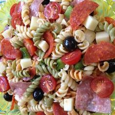 Awesome Pasta Salad: I made it with - 12oz. Tri color rotini, large can sliced black olives, 1/2lb cubed mozzarella, 1/4lb mini turkey pepperoni, 1/8lb quartered salami, large green pepper, 16oz robust Italian dressing