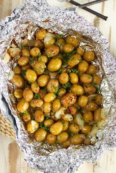 Easy Grilled Garlic Potatoes in Foil are a fantastic side dish for every occasion. Simple ingredients wrapped up in a pouch and grilled to perfection!