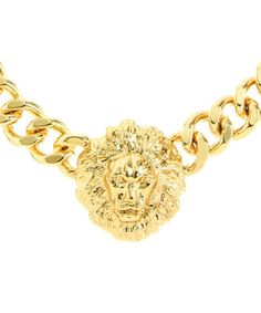 Chunky vintage-inspired necklace with lion head detail. The Queen of the Jungle necklace is available in gold plated or epoxy color plated metal with an adjustable lobster clasp closure. One size.