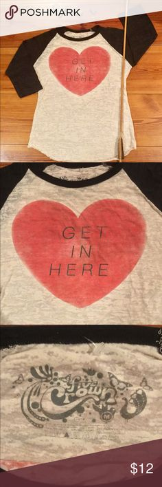 """Heart Baseball Tee Wear your heart on your sleeve with this graphic Tee by Five Crown.  Baseball Tee with black 3/4 sleeve.  Textured """"burnout"""" fabric adds interest and softness.  Soft rose colored heart says it all!  Poly/ Cotton Blend.  Size Medium. Five Crown Tops Sweatshirts & Hoodies"""