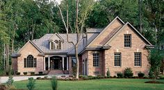Plan of the Week! Over 2500 sq ft - The Milford, plan 331. This open floor plan is accented with columns for an elegant touch. http://www.dongardner.com/plan_details.aspx?pid=277. #POTW #Brick #Ranch