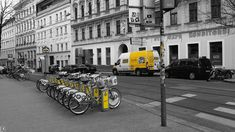 Urban yellow @Vienna #urban_yellow #yellow_bikes #yellow_car #greyscale #blackandwhite_photography #urban_photography #Vienna #Siebensterngasse #illustration #repetition #urbanism #travel