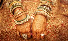 How beautiful is this shot of the bride's bangles and mehendi.
