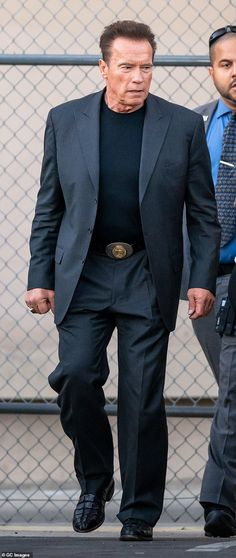 Dapper: Schwarzenegger was dressed all in black pairing a two-piece suit with a round neck.
