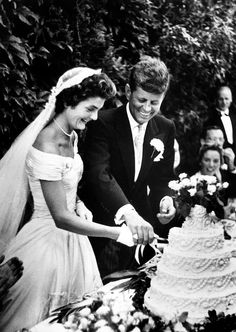 September 12, 1953 -- Jacqueline Lee Bouvier and John F. Kennedy were married on the morning of September 12, 1953, in the picturesque St. Mary's Roman Catholic Church in Newport, Rhode Island. Seen here are the newlyweds cutting their cake.   © John F. Kennedy Presidential Library and Museum