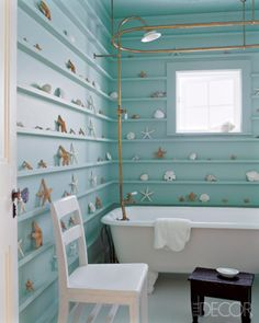 Love the use of natural materials in this lovely seafoam colored bathroom.