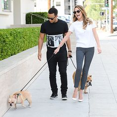 John Legend with wife Chrissy Teigen & their dogs Milk Studios, Star Track, Dog Runs, Pants Pattern, Celebs, Celebrities, Smart Casual, New Girl, Pop Fashion