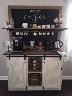 This Piece measures 52 wide, top shelf is 57 wide. Total height to top is 78. The counter depth is 20, inside depth is 15.5 with counter top height at 36. Top, and frame are solid Maple stained in espresso, topped with poly. Back is chalkboard, with black iron shelf support, and cup hooks which can be easily removed if needed. Two front doors are cross buck and slide to the middle. All hardware is handmade from scratch and painted black. Please allow 4-6 weeks for shipping. This piece ships…