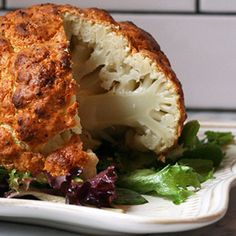 Whole Roasted Cauliflower, serve with flavorful sauce.